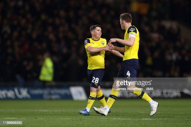 Liam Kelly of Oxford United celebrates after scoring a goal to make it 1-2 with Rob Dickie during the FA Cup Fourth Round Replay match between Oxford...