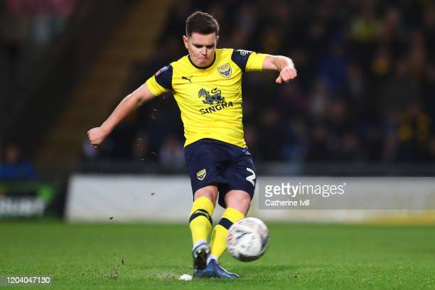 Liam Kelly of Oxford United scores his team's first goal from a freekick during the FA Cup Fourth Round Replay match between Oxford United and...