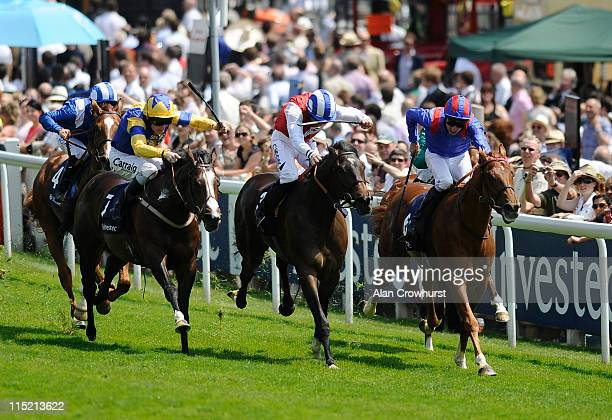Liam Keniry riding Charles Camoin win The Investec Horses Help Heroes Stakes during The Derby Festival at Epsom racecourse on June 04 2011 in Epsom...
