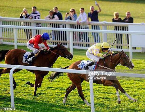 Liam Keniry riding Croquembouche win The Download Coral Mobile From The App Store Handicap Stakes at Windsor racecourse on August 12 2013 in Windsor...