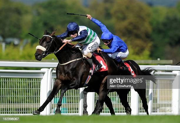 Liam Keniry riding Havana Beat win The British Stallion Studs Supporting British Racing EBF Maiden Stakes from Restraint Of Trade at Sandown...