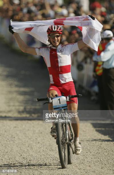 Liam Killeen of England celebrates as he approaches the finish line on his way to victory in the Men's Individual Cross Country Mountain Biking Event...