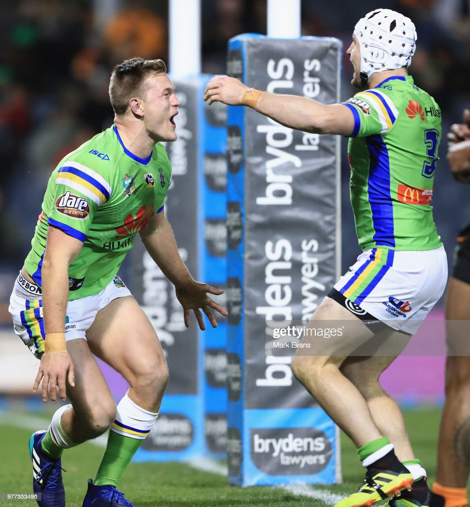 Liam Knight of the Raiders celebrates a try with Jarrod Croker of the Raiders during the round 15 NRL match between the Wests Tigers and the Canberra Raiders at Campbelltown Sports Stadium on June 17, 2018 in Sydney, Australia.