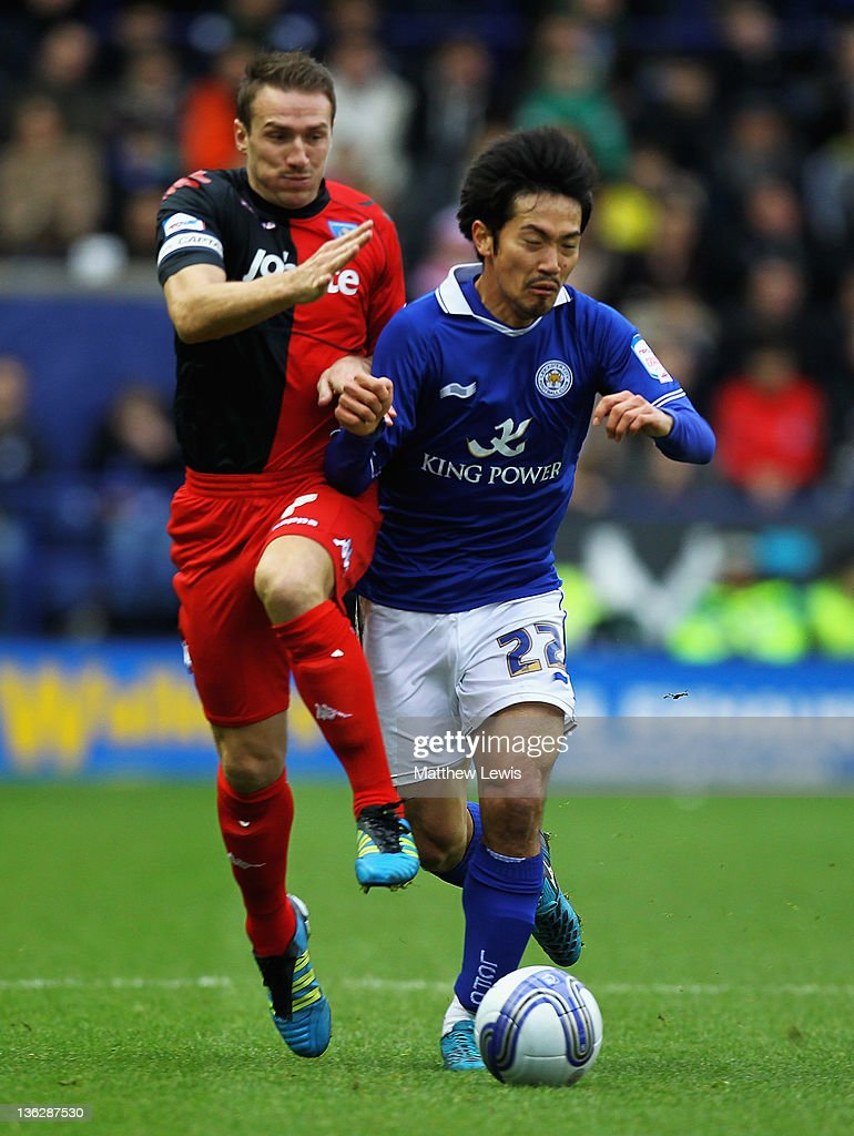 Liam Lawrence of Portsmouth and Yui Abe of Leicester challenge for the ball during the npower Championship match between Leicester City and Portsmouth at The King Power Stadium on December 31, 2011 in Leicester, England.
