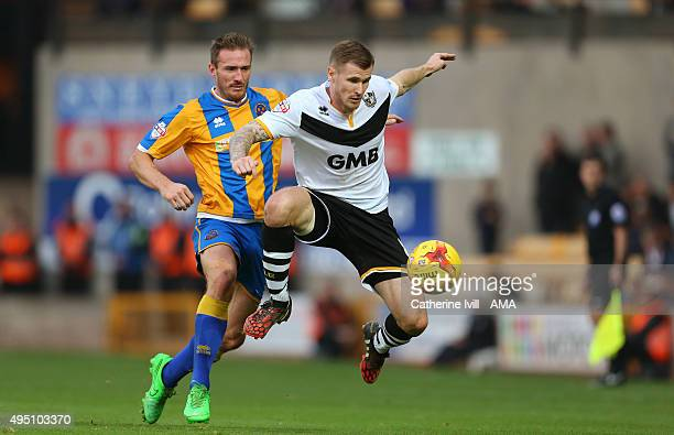 Liam Lawrence of Shrewsbury Town and Michael O' Connor of Port Vale during the Sky Bet League One match between Port Vale and Shrewsbury Town at Vale...
