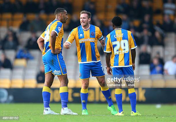 Liam Lawrence of Shrewsbury Town gives instructions to Tyrone Barnett and Larnell Cole of Shrewsbury Town during the Sky Bet League One match between...