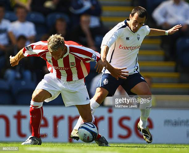Liam Lawrence of Stoke City and Ross Wallace of Preston challenge for the ball during the Pre Season Friendly match between Preston North End and...