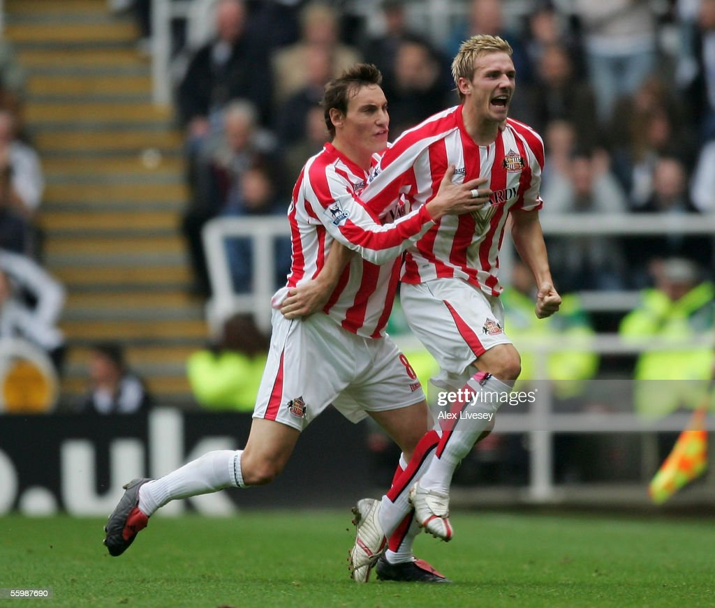Liam Lawrence of Sunderland celebrates his goal with Dean Whitehead during the Barclays Premiership match between Newcastle United and Sunderland at St James' Park on October 23, 2005 in Newcastle, England.