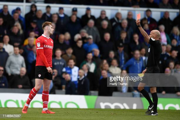 Liam Lindsay of Barnsley is shown a second yellow and therefore a red card by referee Darren Drysdale during the Sky Bet League One match between...