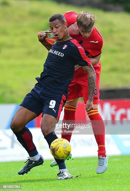 Liam Lindsay of Patrick Thistle challenges with Jonson ClarkeHarris of Rotherham during a pre season friendly match between Patrick Thistle FC and...