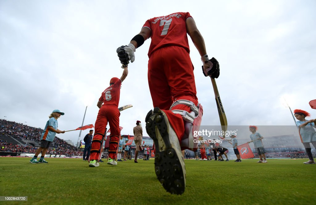 Liam Livingstone and Jos Buttler of Lancashire walks out to bat during the Vitality Blast match between Lancashire Lighting and Yorkshire Vikings at Old Trafford on July 20, 2018 in Manchester, England.