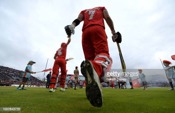 Liam Livingstone and Jos Buttler of Lancashire walks out to bat during the Vitality Blast match between Lancashire Lighting and Yorkshire Vikings at...