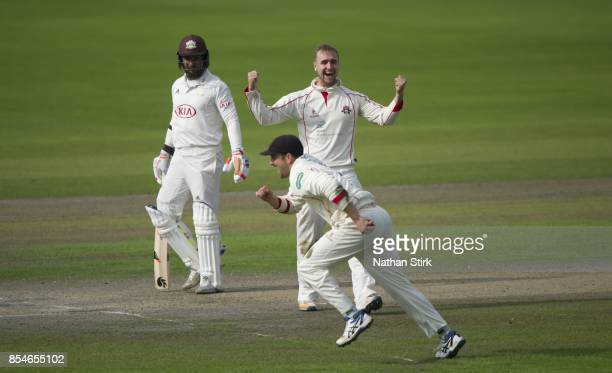 Liam Livingstone celebrates with Steven Parry after they get Ben Foakes of Surrey out during the County Championship Division One match between...