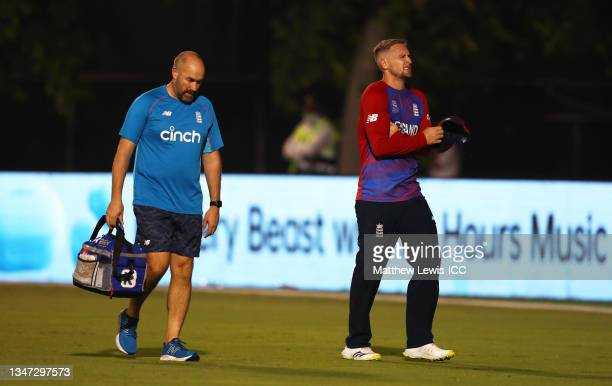 Liam Livingstone of England receives medical attention during the India and England warm Up Match prior to the ICC Men's T20 World Cup at on October...