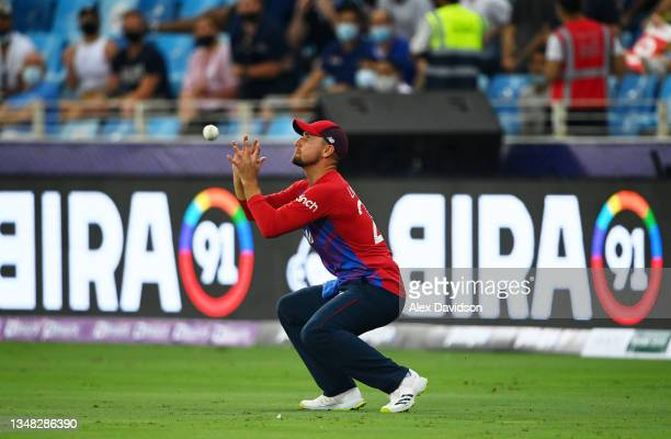 Liam Livingstone of England takes a catch to dismiss Lendl Simmons of West Indies during the ICC Men's T20 World Cup match between England and...