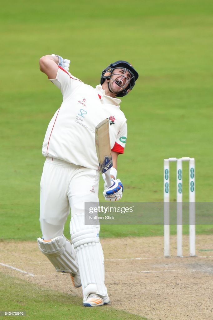 Liam Livingstone of Lancashire celebrates after scoring 100 runs during the County Championship Division One match between Lancashire and Warwickshire at Old Trafford on August 29, 2017 in Manchester, England.