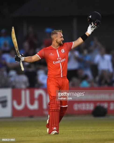 Liam Livingstone of Lancashire celebrates as he scores 100 runs during the Vitality Blast match between Derbyshire Falcons and Lancashire Lightning...