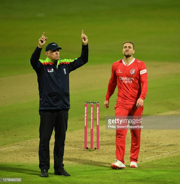 Liam Livingstone of Lancashire reacts as umpire David Millns signals a fourth six hit by Dan Christian of Notts during the Vitality T20 Blast semi...