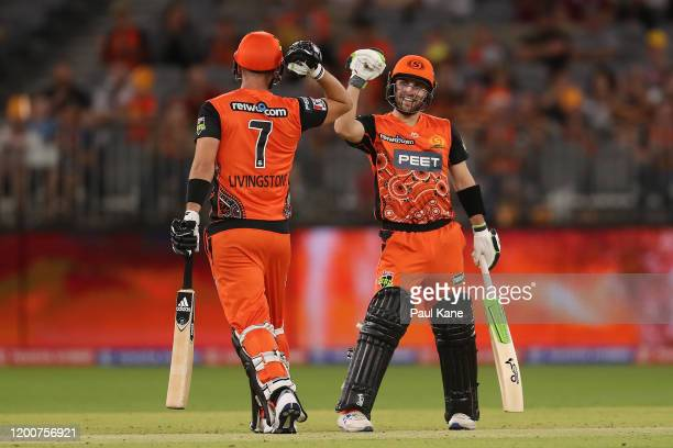 Liam Livingstone of the Scorchers and Josh Inglis of the Scorchers celebrate a six during the Big Bash League match between the Perth Scorchers and...