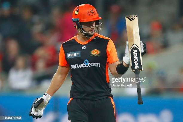 Liam Livingstone of the Scorchers raises his bat after making fifty runs during the Big Bash League T20 match between the Melbourne Renegades and the...