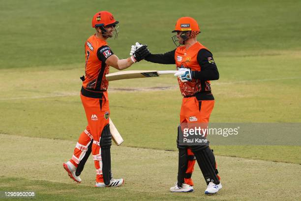 Liam Livingstoneand Jason Royof the Scorchers celebrate bringing up the 100 during the Big Bash League match between the Perth Scorchers and the...