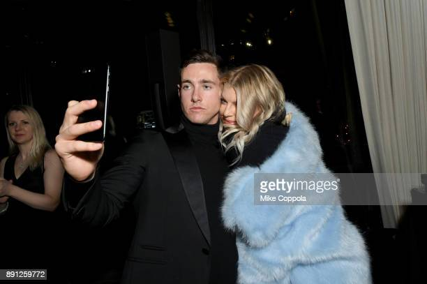 Liam Malone and Fergie attends the CR Fashion Book Celebrating launch of CR Girls 2018 with Technogym at Spring Place on December 12 2017 in New York...