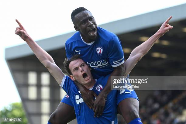 Liam Mandevilleof Chesterfield celebrates with teammate Emmanuel Oyeleke after scoring their team's second goal during the Vanarama National League...