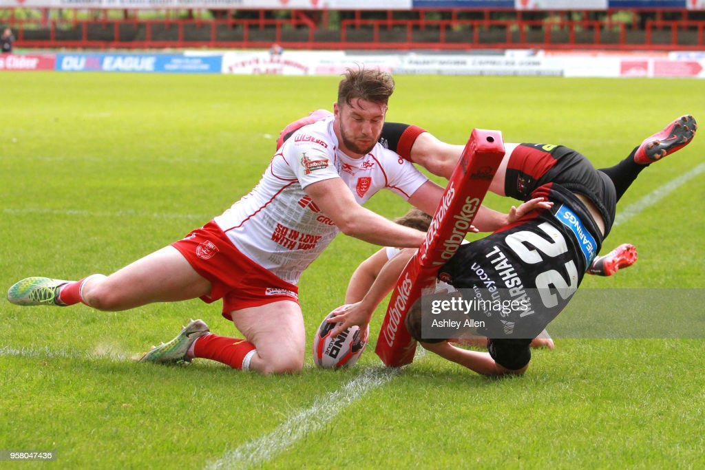 Liam Marshall of Wigan Warriors dives in to score a Try during round six of the Ladbrokes Challenge Cup at KCOM Craven Park on May 13, 2018 in Hull, England.