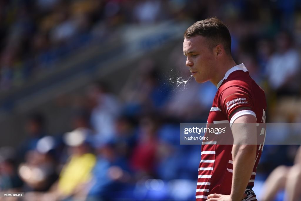 Liam Marshall of Wigan Warriors rinses his mouth out during the Ladbrokes Challenge Cup Quarter-Final match between Warrington Wolves and Wigan Warriors at Halliwell Jones Stadium on June 17, 2017 in Warrington, England.