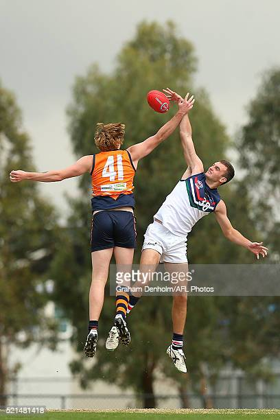 Liam Maze of the NSW/ACT Rams competes in the air with Mitchell Barnes of the Calder Cannons during the round three TAC Cup match between Calder...