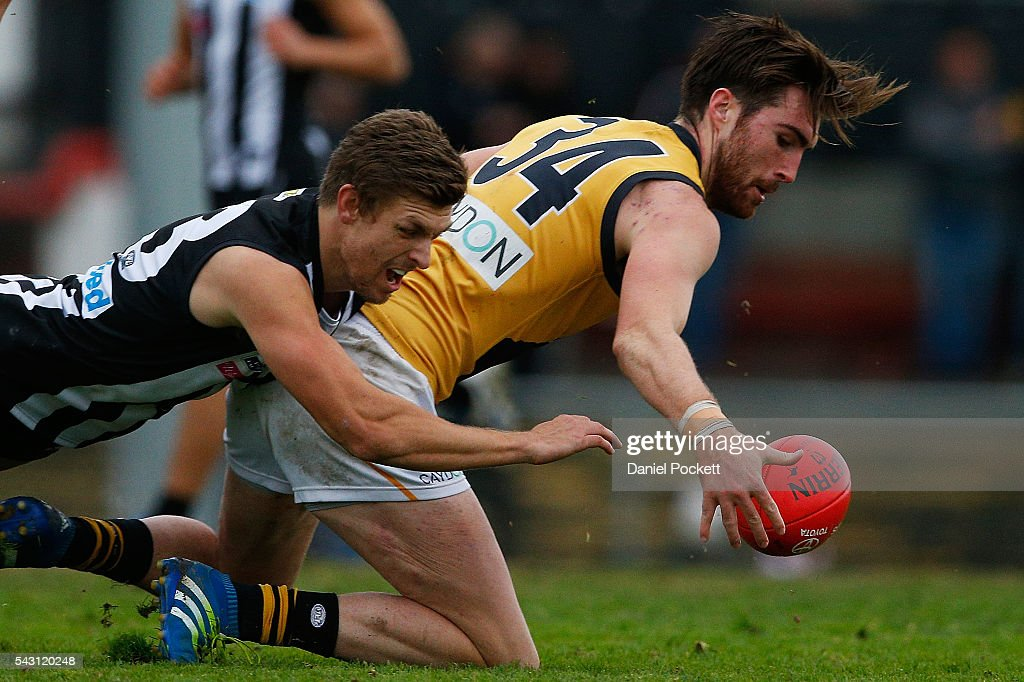 Liam McBean of the Tigers and Adam Oxley of the Magpies compete for the ball during the round 12 VFL match between the Collingwood Magpies and the Richmond Tigers at Victoria Park on June 26, 2016 in Melbourne, Australia.
