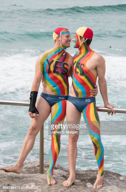 Liam McDermid and Rob Page lifesavers at Tamarama Surf lifesaving club in body paint take part in the Rainbow Walk between Bondi Beach and Bronte...