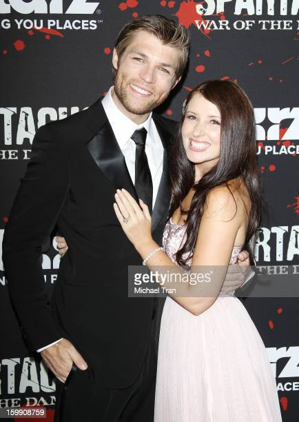 Liam McIntyre and Erin Hasan arrive at the Los Angeles premiere of Spartacus War Of The Damned held at Regal Cinemas LA LIVE Stadium 14 on January 22...