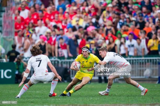 Liam McNamara of Australia is tackled during the 2017 Hong Kong Sevens match between England and Australia at Hong Kong Stadium on April 8 2017 in...