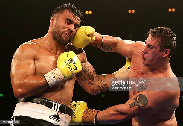 Liam Messam fights Rhys Sullivan during their heavyweight bout during the Footy Show Fight Night at Allphones Arena on January 31, 2015 in Sydney,...