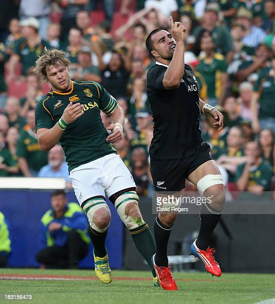Liam Messam of the All Blacks celebrates after scoring his second try during the Rugby Championship match between South Africa Springboks and the New...
