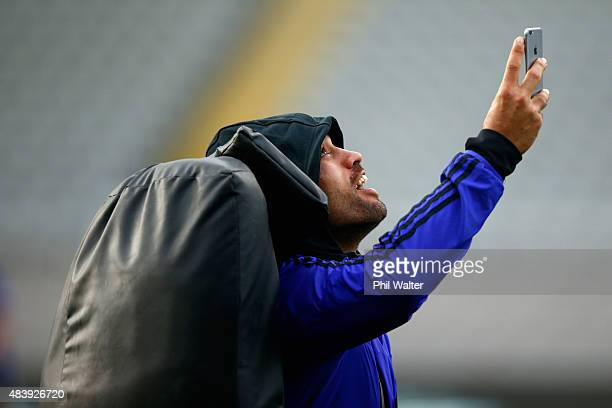 Liam Messam of the All Blacks takes a selfie on a smart phone during a New Zealand All Blacks Captain's Run at Eden Park on August 14 2015 in...