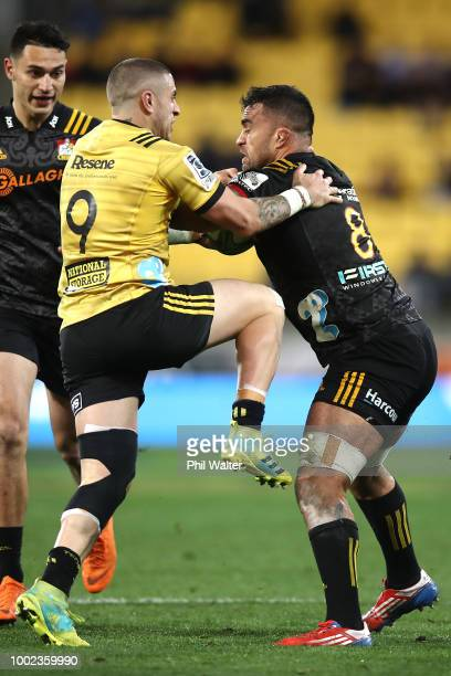 Liam Messam of the Chiefs is tackled by TJ Perenara during the Super Rugby Qualifying Final match between the Hurricanes and the Chiefs at Westpac...