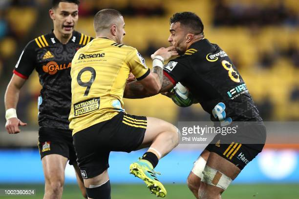 Liam Messam of the Chiefs is tackled by TJ Perenara of the Hurricanes during the Super Rugby Qualifying Final match between the Hurricanes and the...