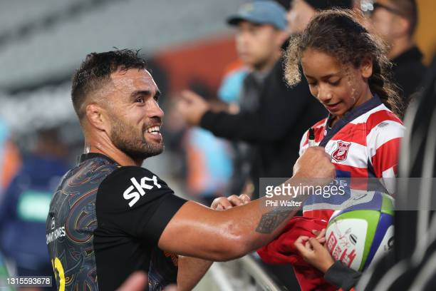 Liam Messam of the Chiefs signs autographs following the round 10 Super Rugby Aotearoa match between the Blues and the Chiefs at Eden Park, on May 01...