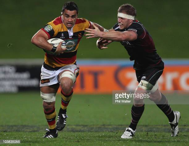 Liam Messam of Waikato is tackled by Richard Mayhew of North Harbour during the round six ITM Cup match between North Harbour and Waikato at North...