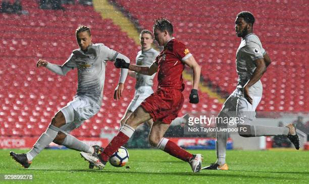 Liam Millar of Liverpool and Cameron BorthwickJackson of Manchester United in action during the Premier League 2 match between Liverpool and...