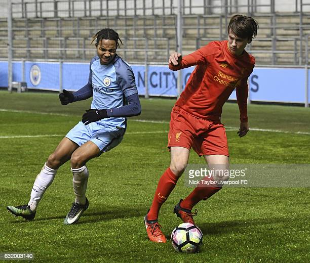 Liam Millar of Liverpool and Demeaco Duhaney of Manchester City in action during the Manchester City v Liverpool FA Youth Cup game at Etihad Campus...