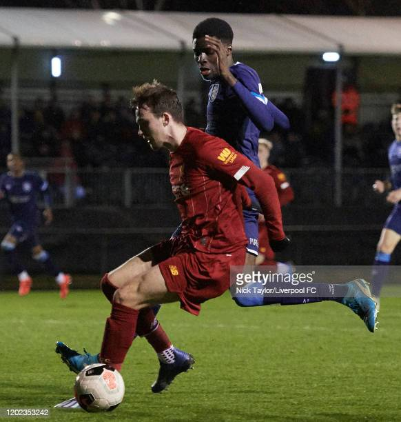 Liam Millar of Liverpool and Demeaco Duhany of Huddersfield Town in action during the Premier League Cup game at the Academy on February 21 2020 in...