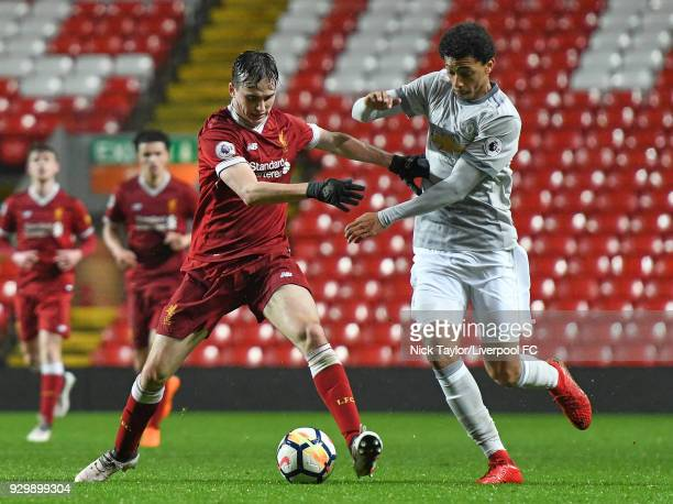 Liam Millar of Liverpool and Devonte Redmond of Manchester United in action during the Premier League 2 match between Liverpool and Manchester United...