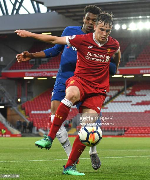 Liam Millar of Liverpool and Dujon Sterling of Chelsea in action during the Liverpool v Chelsea PL2 game at Anfield on May 8 2018 in Liverpool England