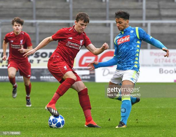 Liam Millar of Liverpool and Giovanni Calvano of SSC Napoli in action during the UEFA Youth League match between Liverpool and SSC Napoli at Langtree...