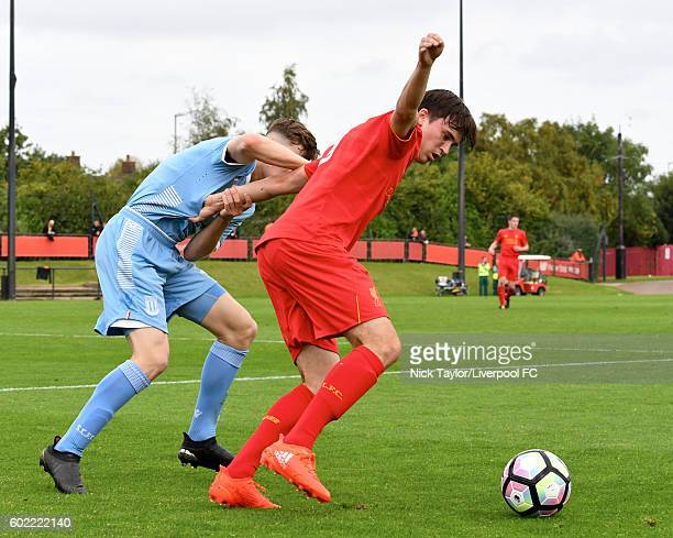 Liam Millar of Liverpool and Jacob Twyford of Stoke City in action during the U18 Premier League game between Liverpool and Stoke City at the Kirkby...