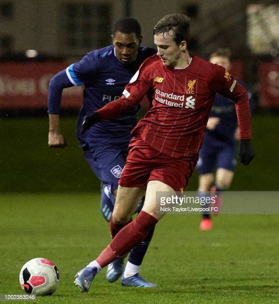 Liam Millar of Liverpool and Jaden Brown of Huddersfield Town in action during the Premier League Cup game at the Academy on February 21 2020 in...