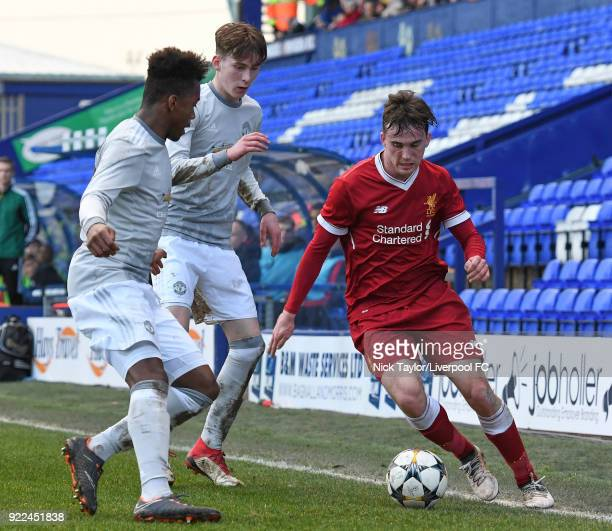Liam Millar of Liverpool and James Garner and Ethan Laird of Manchester United in action during the Liverpool v Manchester United UEFA Youth League...
